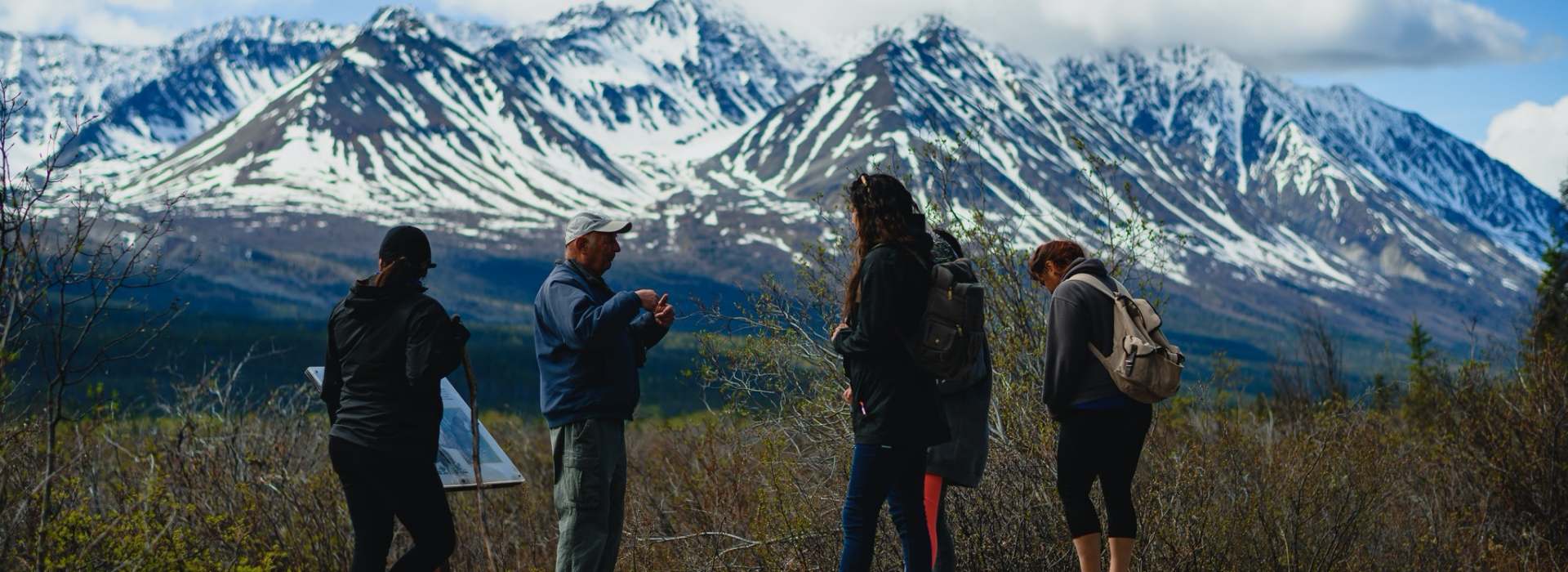 People in front of mountains